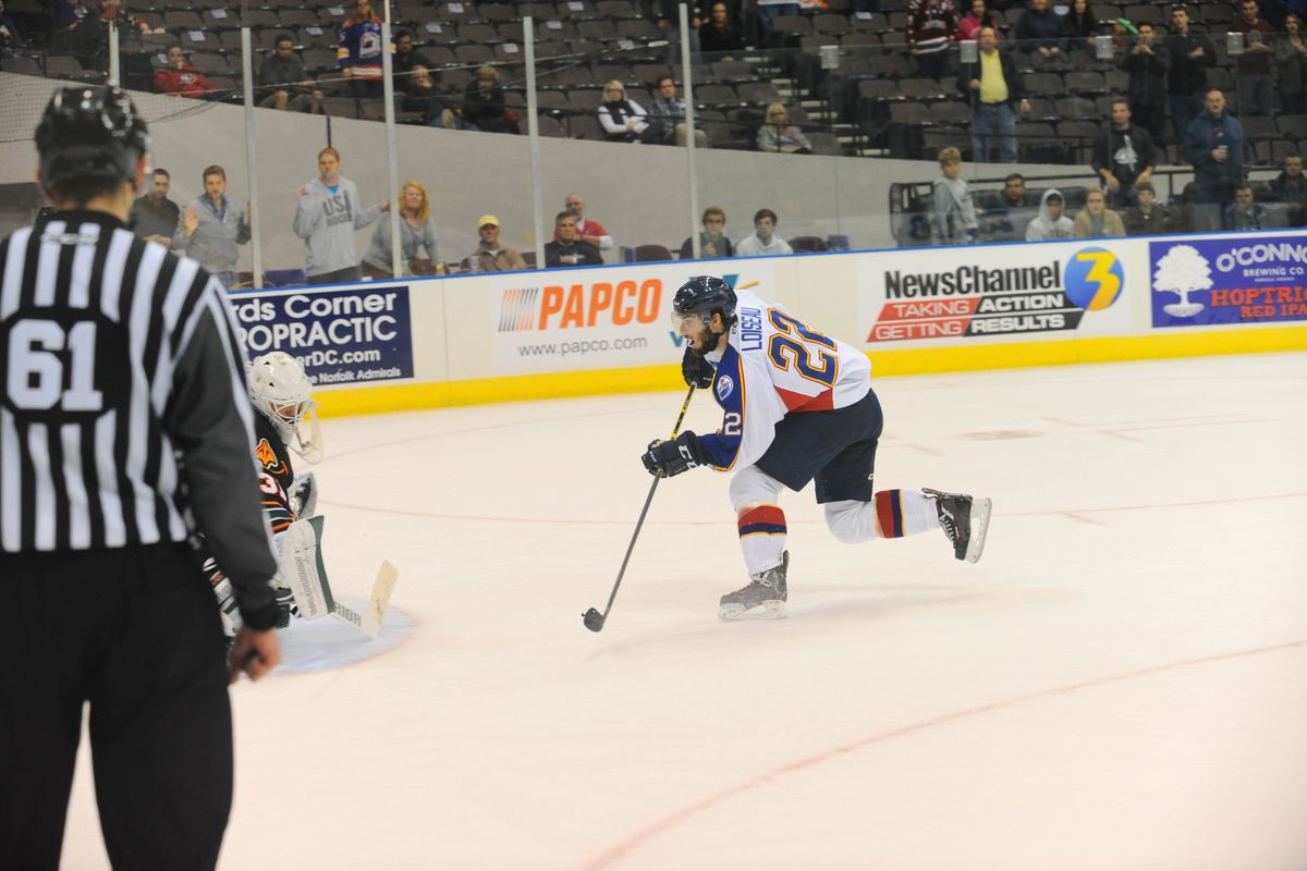 Norfolk Admirals' forward Alexis Loiseau scores the shoot-out winning goal against the Quad City Mallards October 30, 2015