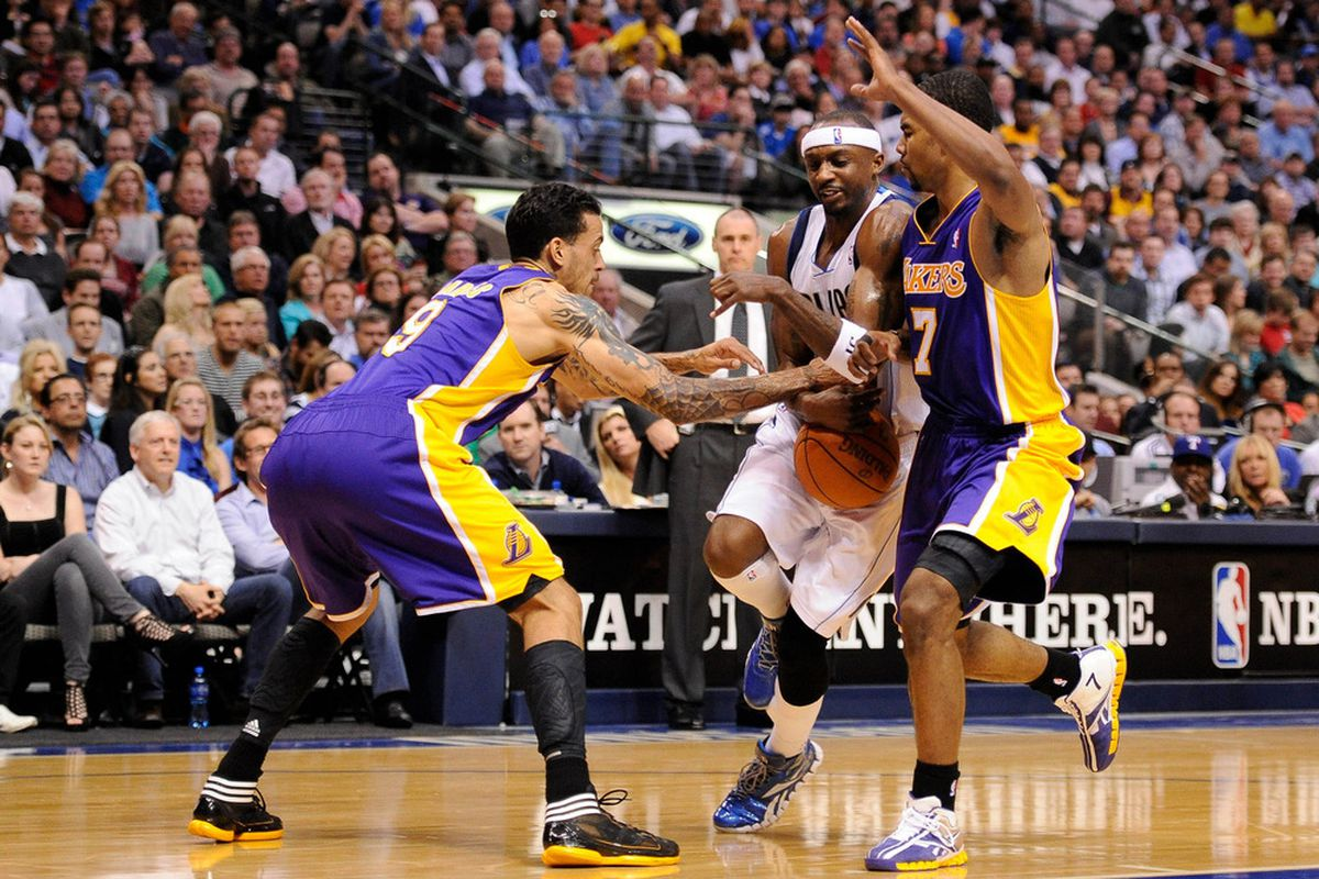 Mar 21, 2012; Dallas, TX, USA; Dallas Mavericks shooting guard Jason Terry (31) is fouled by Los Angeles Lakers small forward Matt Barnes (9) during the second quarter at the American Airlines Center. Mandatory Credit: Jerome Miron-US PRESSWIRE