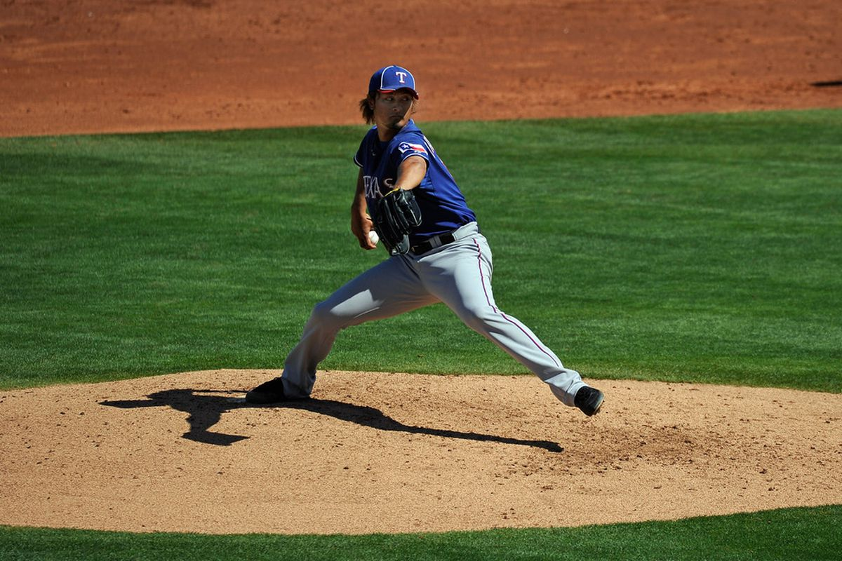 GOODYEAR, AZ - MARCH 13:  Yu Darvish #11 of the Texas Rangers throws a pitch during the third inning of a spring training baseball game against the Cleveland Indians on March 13, 2012 in Goodyear, Arizona.  (Photo by Kevork Djansezian/Getty Images)