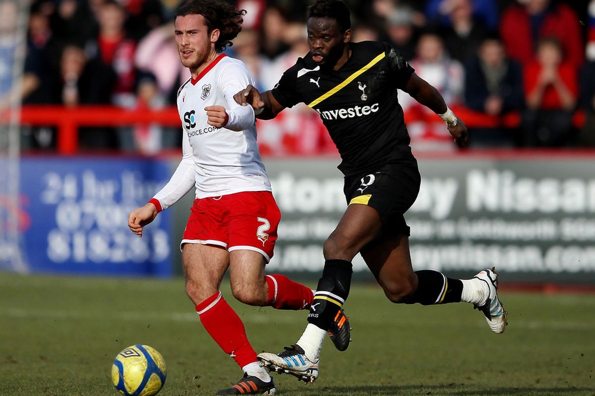 Lawrie Wilson of Stevenage and Louis Saha of Tottenham during the FA Cup Fifth Round match between Stevenage and Tottenham Hotspur at The Lamex Stadium on February 19, 2012 in Stevenage, England.
