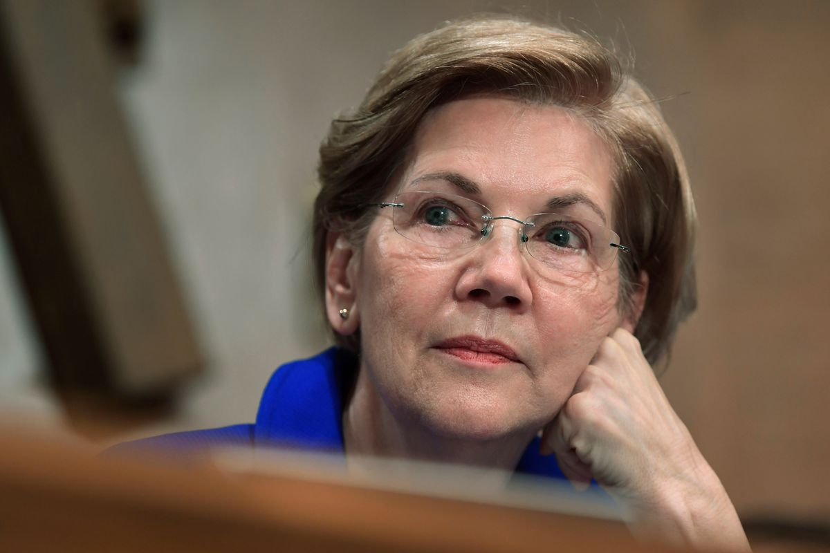 FILE - In this Dec. 5, 2017, file photo, Sen. Elizabeth Warren, D-Mass., waits to speak during a meeting of the Senate Banking Committee on Capitol Hill in Washington. Warren is striking back at President Donald Trump over his constant ridicule of her cla