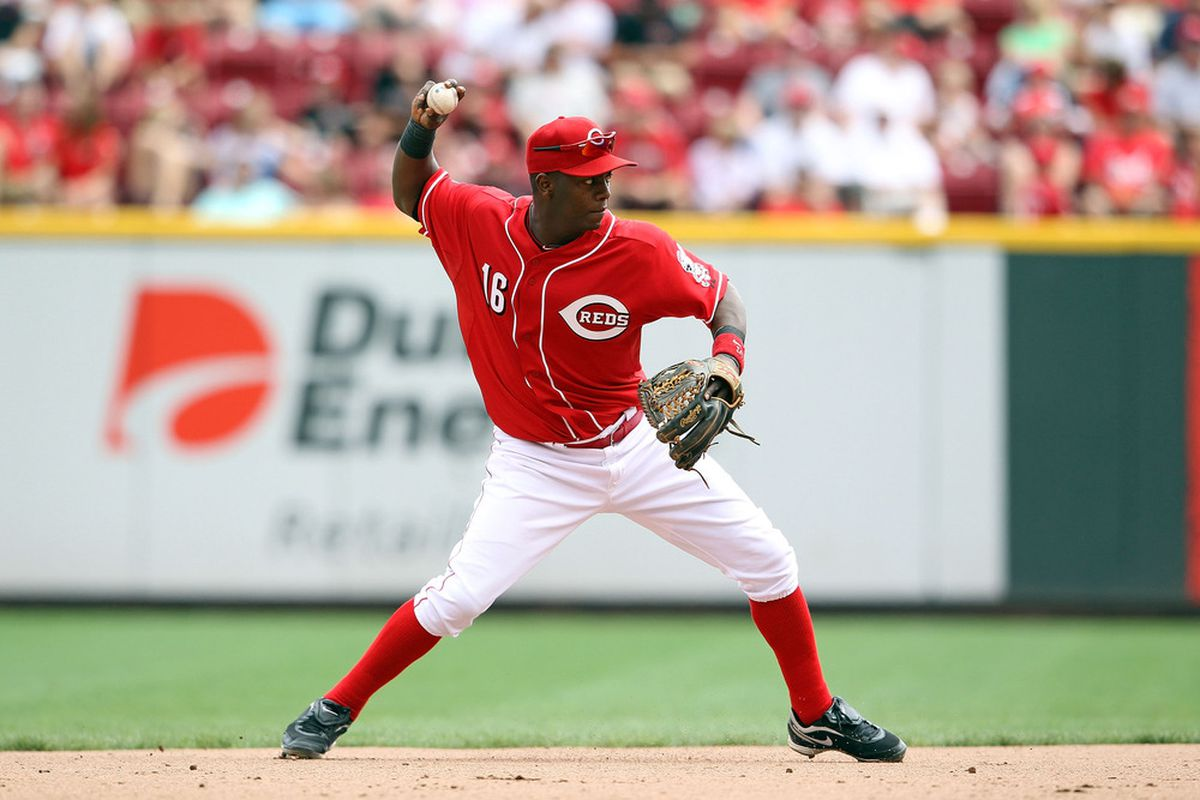 CINCINNATI, OH - AUGUST 14:  Edgar Renteria #16  of the Cincinnati Reds throws to first base during the game against the San Diego Padres at Great American Ball Park on August 14, 2011 in Cincinnati, Ohio.  (Photo by Andy Lyons/Getty Images)