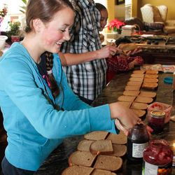 Pierce, 15, and Hannah, 13, make the family sandwiches for lunch with their cousin, Chloe. Deanne Walker says she and her family prefer homemade bread, so rather than buying their bread at the store she bakes five loaves nearly every morning for her family.