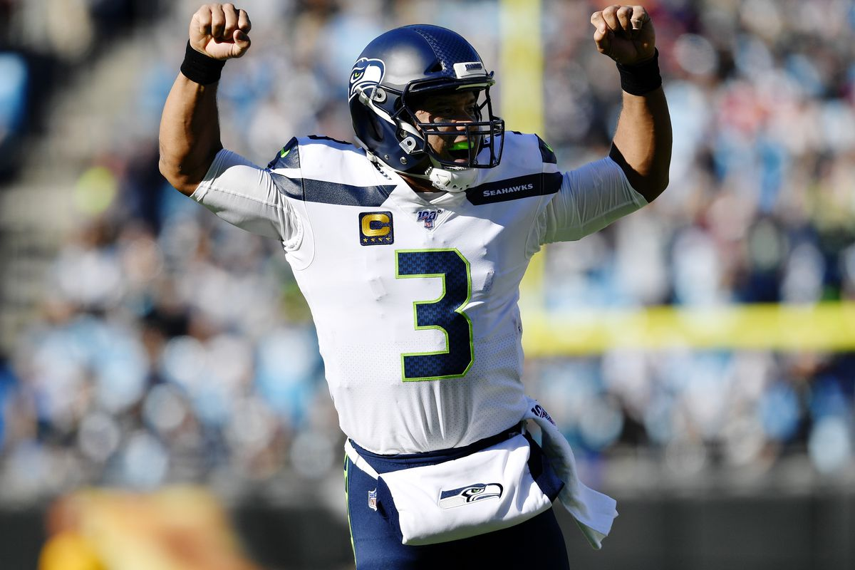 Seattle Seahawks quarterback Russell Wilson #3 reacts to throwing a touchdown pass against Carolina Panthers in the first quarter at Bank of America Stadium on December 15, 2019 in Charlotte, North Carolina.