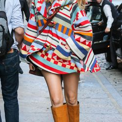 In a Lindsey Thornburg cloak and heeled boots on October 17th, 2014.