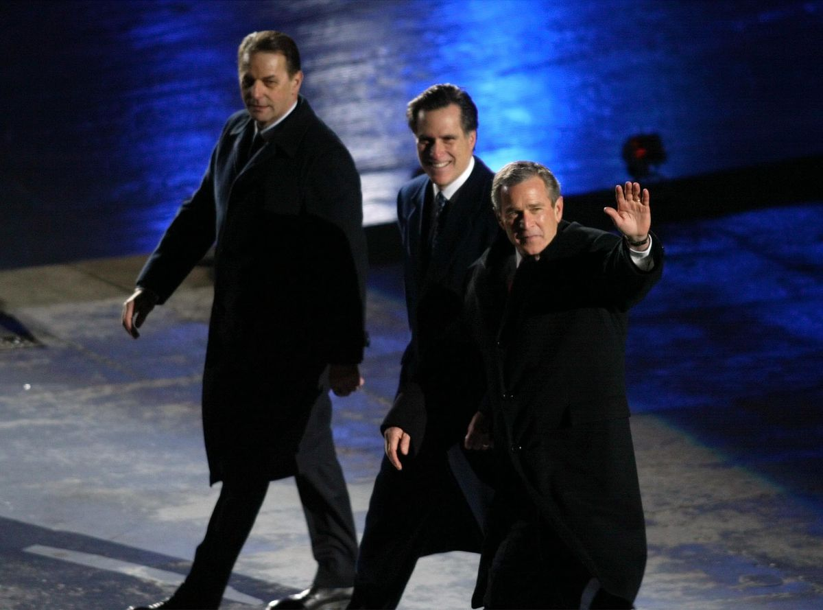IOC President Dr. Jaques Rogge, SLOC President Mitt Romney and the President of the United States George W. Bush wave the crowd before moving to their seats during the Salt Lake 2002 Olympic Winter Games Opening Ceremony at Rice-Eccles Stadium, Friday, Feb 8, 2002.