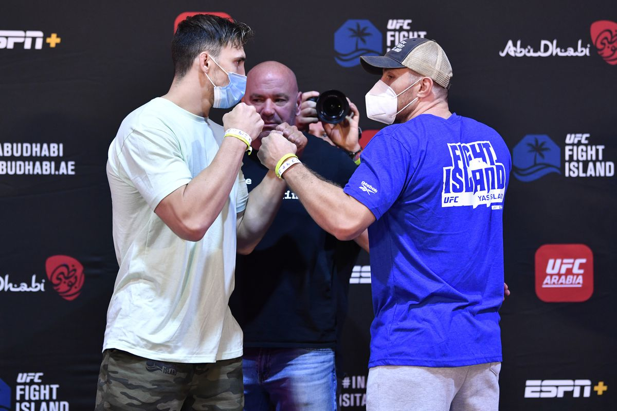 Opponents Modestas Bukauskas of Lithuania and Andreas Michailidis of Greece face off during the UFC Fight Night weigh-in inside Flash Forum on UFC Fight Island on July 14, 2020 in Yas Island, Abu Dhabi, United Arab Emirates.