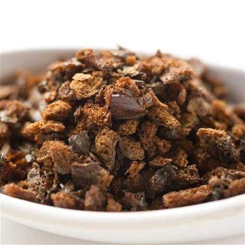 A pile of brown soy salt