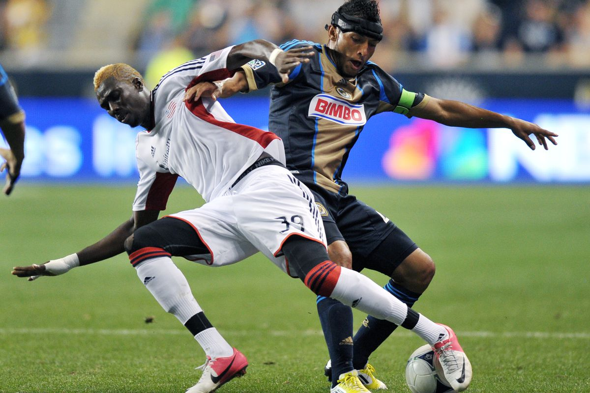 CHESTER, PA - JULY 29: Saer Sene #39 of the New England Revolution and Carlos Valdes #2 of the Philadelphia Union battle for the ball at PPL Park on July 29, 2012 in Chester, Pennsylvania. The Union won 2-1. (Photo by Drew Hallowell/Getty Images)