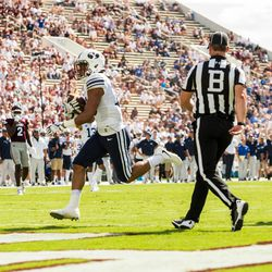 BYU wide receiver Aleva Hifo catches a 27-yard touchdown pass during the third quarter against Mississippi State at Davis Wade Stadium in Starkville, Miss., on Saturday, Oct. 14, 2017.