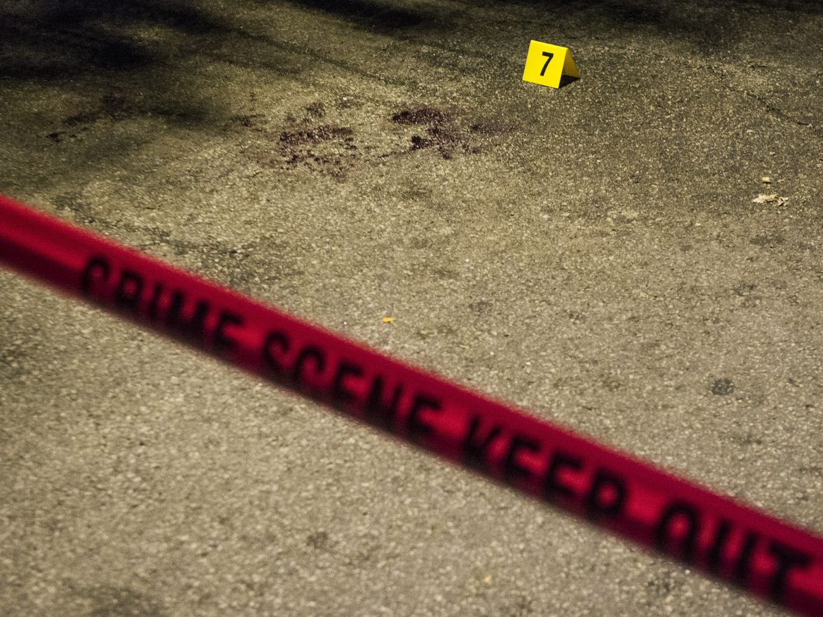 Evidence marker seven marks blood at the scene where four people were shot Sunday night in the 2200 block of South Sacramento in Chicago.   Tyler LaRiviere/Sun-Times