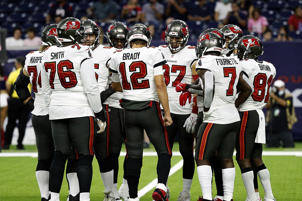 Tom Brady #12 of the Tampa Bay Buccaneers huddles his offense against the Houston Texans during a NFL preseason game at NRG Stadium on August 28, 2021 in Houston, Texas.