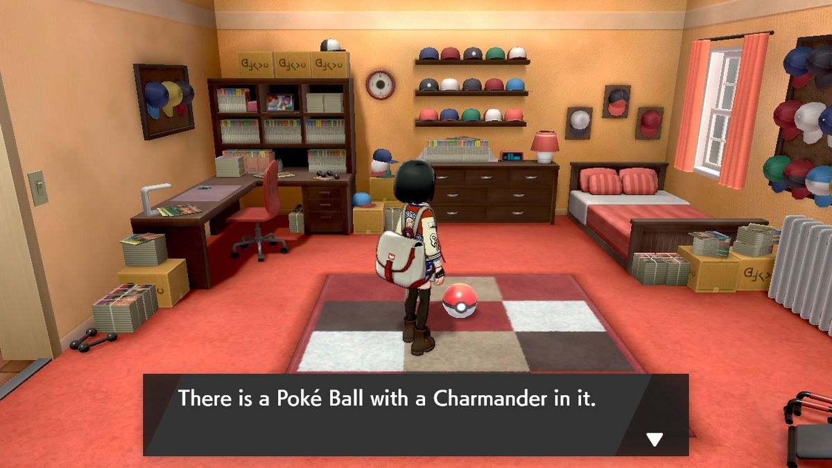 A Pokémon trainer stands in Leon's bedroom and looks at a Poké Ball