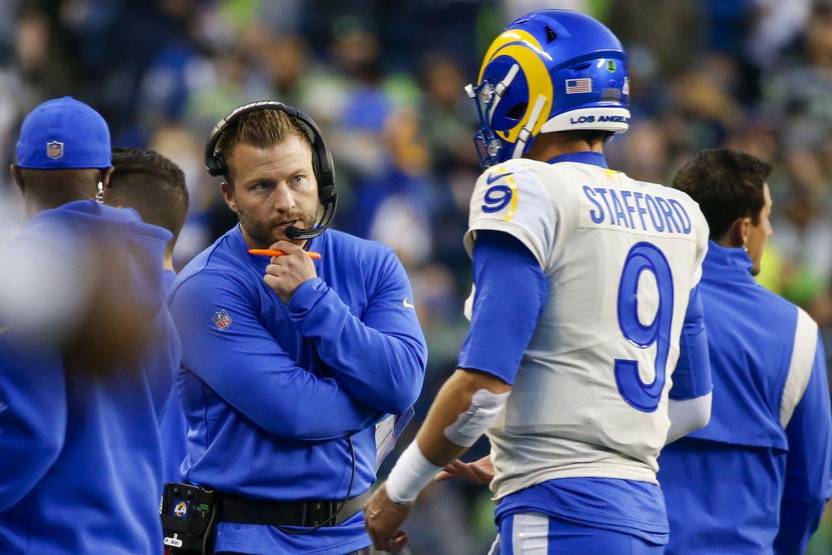 Los Angeles Rams head coach Sean McVay talks with quarterback Matthew Stafford (9) following a second quarter series against the Seattle Seahawks at Lumen Field.