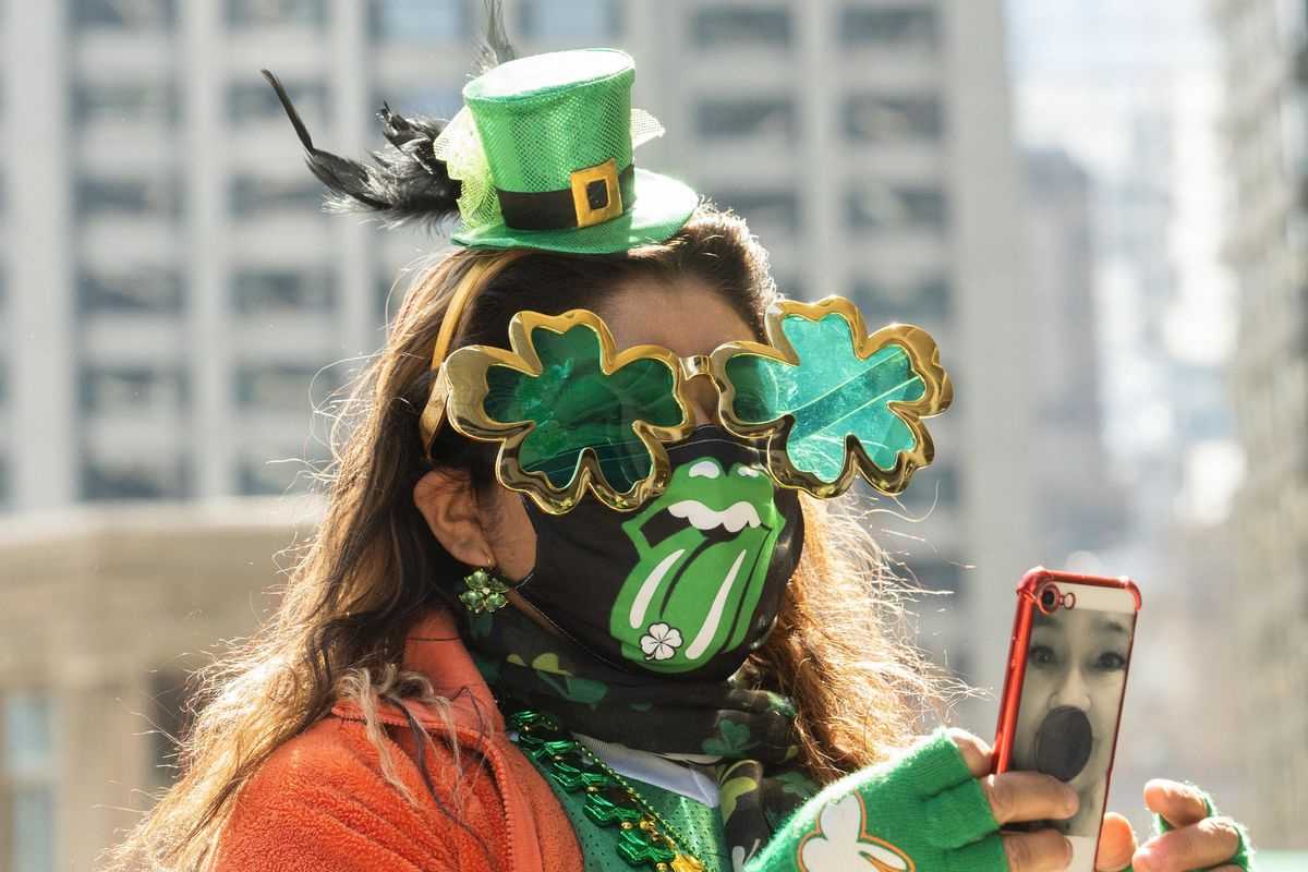 Adriana Arizola, dressed for St. Patrick's Day, takes a picture in River North, Saturday afternoon.