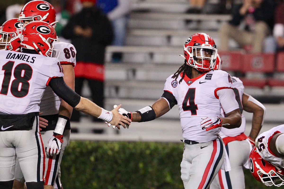 James Cook #4 of the Georgia Bulldogs celebrates after scoring a touchdown against the South Carolina Gamecocks at Williams-Brice Stadium on November 28, 2020 in Columbia, South Carolina.
