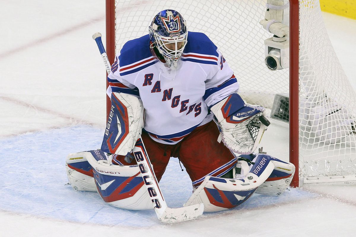 May 21, 2012; Newark, NJ, USA; New York Rangers goalie Henrik Lundqvist (30) makes a glove save during the second period in game four of the 2012 Eastern Conference Finals at the Prudential Center.  Ed Mulholland-US PRESSWIRE