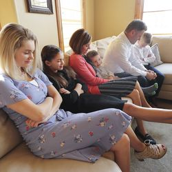 Tyler and Sheree Godfrey listen to a prayer as they watch the 190th Annual General Conference of The Church of Jesus Christ of Latter-day Saints with their children Maddy, Gracie, Boston and Noah from their home in Holladay on Saturday, April 4, 2020.