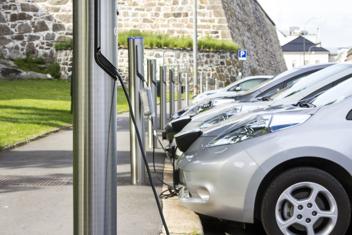 row of electric cars charging