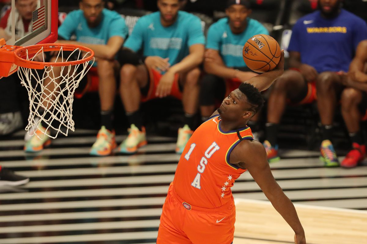 USA forward Zion Williamson of the New Orleans Pelicans dunks the ball during the NBA Rising Stars basketball game at United Center.