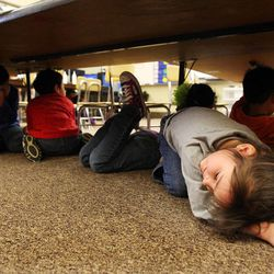 Kindergarten student Ashlynn Hunt participates in an earthquake drill at Vista Elementary in Taylorsville, Tuesday, April 17, 2012.  This was part of the Great Utah ShakeOut.