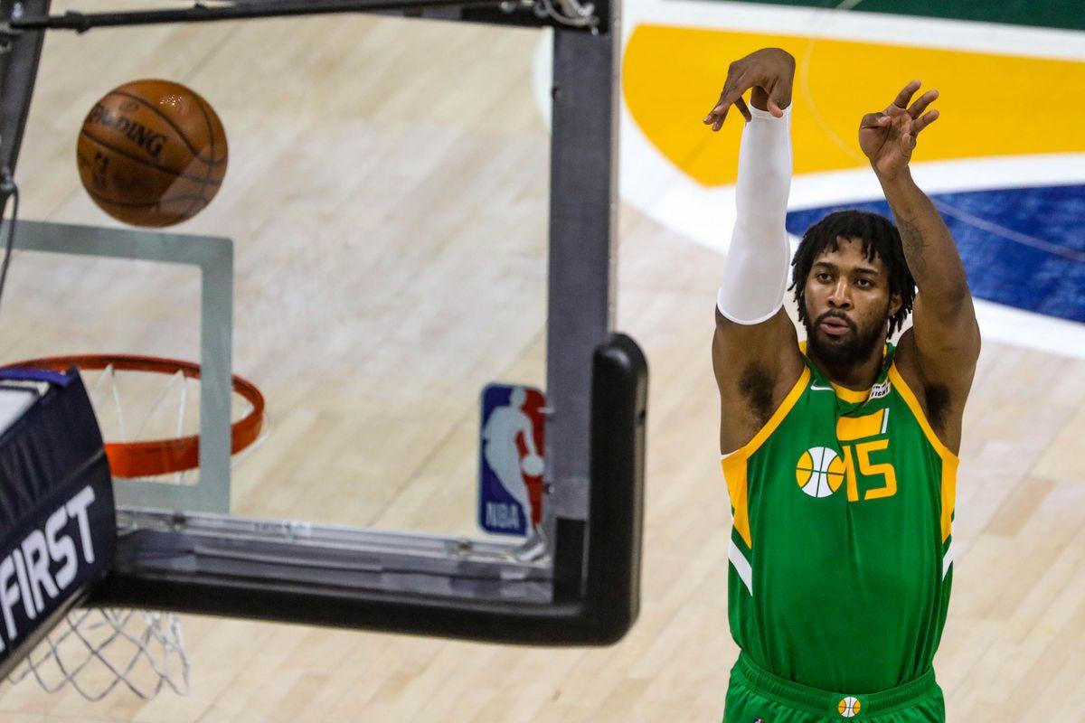Utah Jazz forward Derrick Favors (15) shoots the ball during the game at Vivint Smart Home Arena in Salt Lake City on Thursday, April 8, 2021.