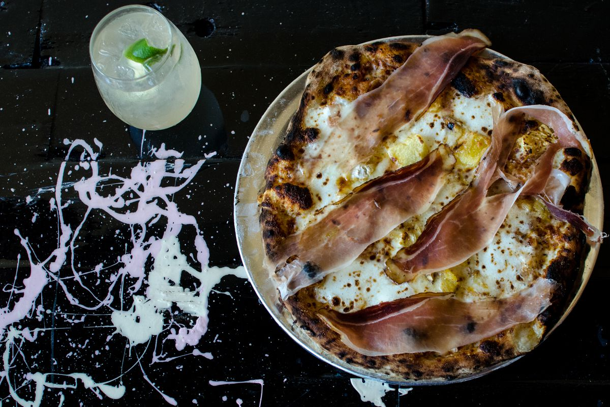 T&B Pizza's pineapple pizza: Tyrolean smoked ham, rum-soaked pineapple, and Jasper Hill Harbison cheese. A spritz on the side (Cocchi Americano, Italicus Rosolio Bergamot Liqueur, prosecco, lime).