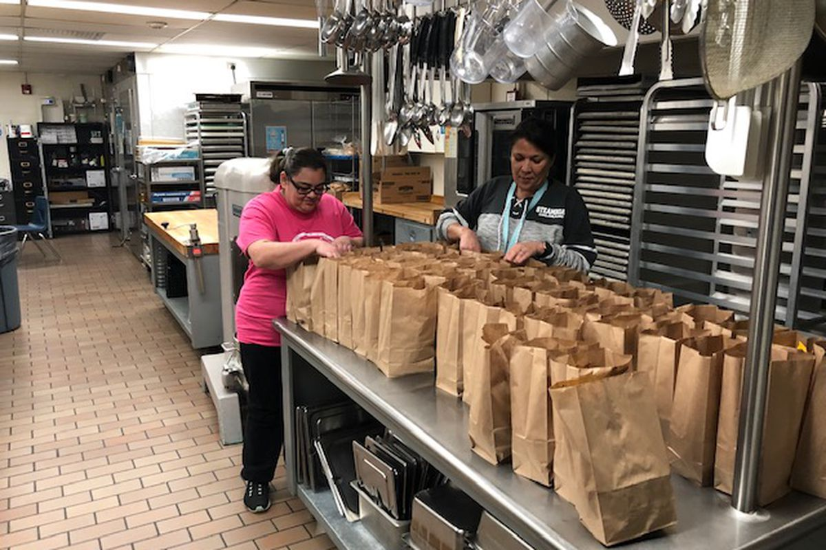 Sheridan staff prepare grab-and-go meals for students during school closures.