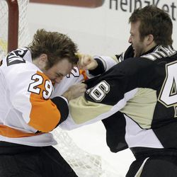 Philadelphia Flyers' Harry Zolnierczyk (29) fights with Pittsburgh Penguins Joe Vitale (46) during the first period of an NHL hockey game against the Pittsburgh Penguins in Pittsburgh Saturday, April 7, 2012.