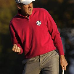 Europe's Ian Poulter reacts after making a birdie putt to with the first hole during a foursomes match at the Ryder Cup PGA golf tournament Saturday, Sept. 29, 2012, at the Medinah Country Club in Medinah, Ill.