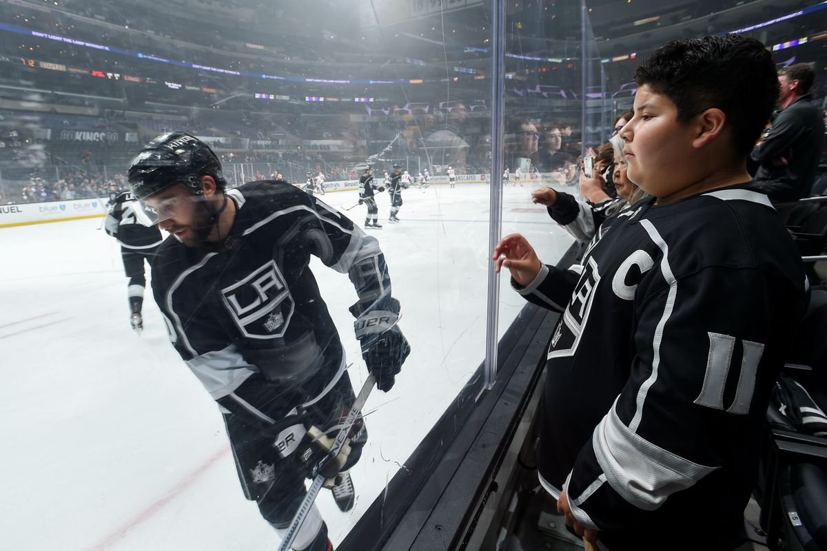 LOS ANGELES, CA - MARCH 11: Los Angeles Kings fan watches Michael Amadio #10 of the Los Angeles Kings during warm ups against the Ottawa Senators at STAPLES Center on March 11, 2020 in Los Angeles, California.