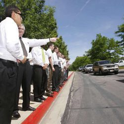 In this 2009 file photo, F. David Smith with the Missionary Training Center in Provo points out a car for an elder to follow and go help as families of missionaries drop them off and say their goodbyes on the curb at the MTC.