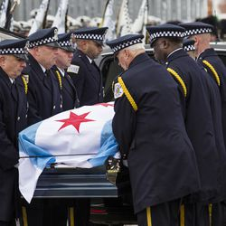 Pallbearers bring in the casket  before the start of his funeral.  | Ashlee Rezin/Sun-Times