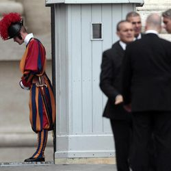 A Vatican Swiss guard and Vatican security staff wait for the arrival of Pope Benedict XVI at the weekly general audience in St. Peter's square at the Vatican, Wednesday, Sept. 26, 2012. Pope Benedict XVI's ex-butler and another Vatican lay employee are scheduled to go on trial Saturday in the embarrassing theft of papal documents that exposed alleged corruption at the Holy See's highest levels.