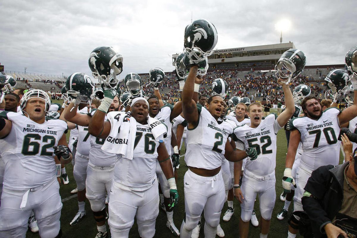 Michigan State players celebrate their 41-7 win over Central Michigan in an NCAA college football game on Saturday, Sept. 8, 2012, in Mount Pleasant, Mich.