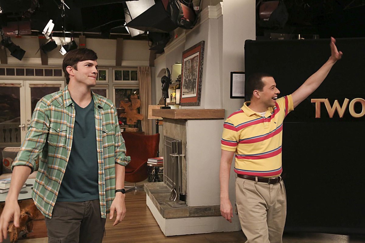 Ashton Kutcher (left) and Jon Cryer greet the audience at the final taping of Two and a Half Men.