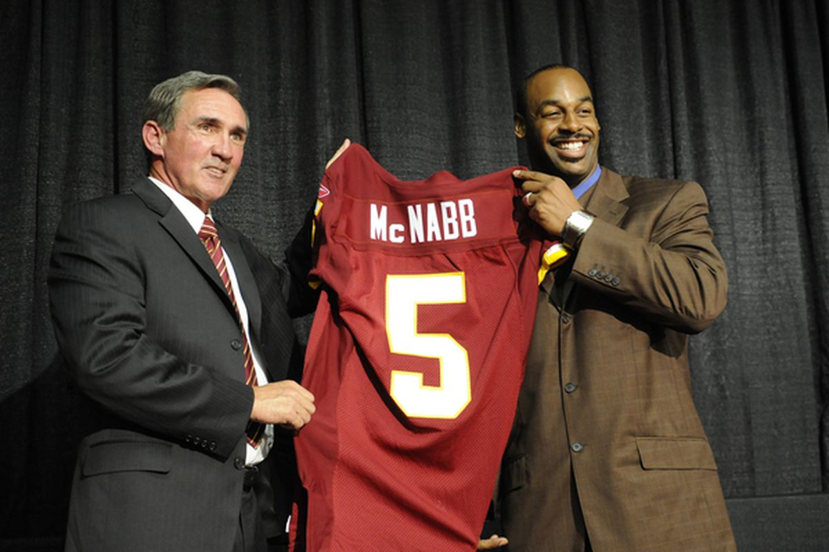 ASHBURN, VA - APRIL 6:  Mike Shanahan, head coach of the Washington Redskins presents Donovan McNabb with his new jersey during a press conference on April 6, 2010 at Redskin Park in Ashburn, Virginia.