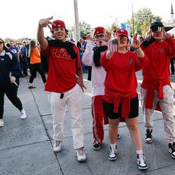 """Utah fans flash their """"U"""" before BYU and Utah play an NCAA football game at LaVell Edwards Stadium in Provo on Saturday, Sept. 11, 2021."""