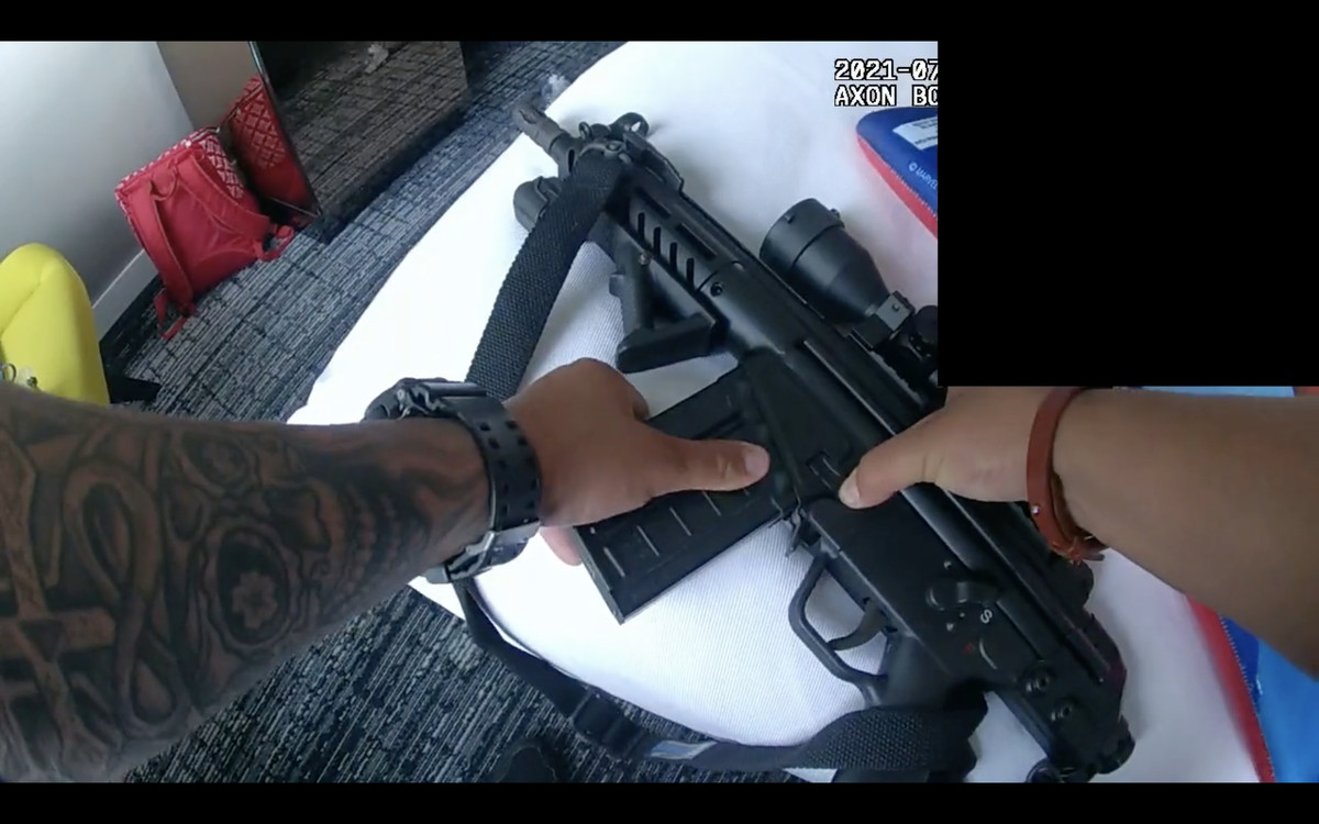 A rifle with an attached scope being recovered by Chicago police inside a downtown hotel room.