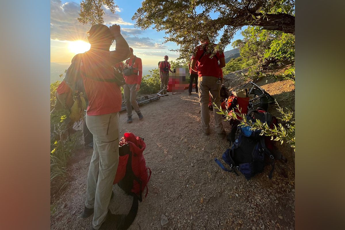 Members of the Salt Lake County Search and Rescue team help an injured hiker get down from Ferguson Canyon on Saturday.