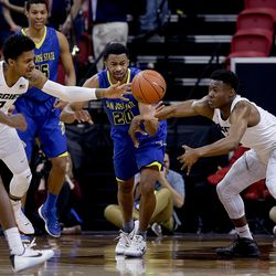 Utah State Aggies 0 Shane Rector, San Jose's 20 Isaac Thornton and Utah State's 1 Koby McEwen compete for a loose ball at the Mountain West Men's Basketball Championships at the Thomas & Mack Center, Las Vegas, Nevada on Wednesday, March 8, 2017.