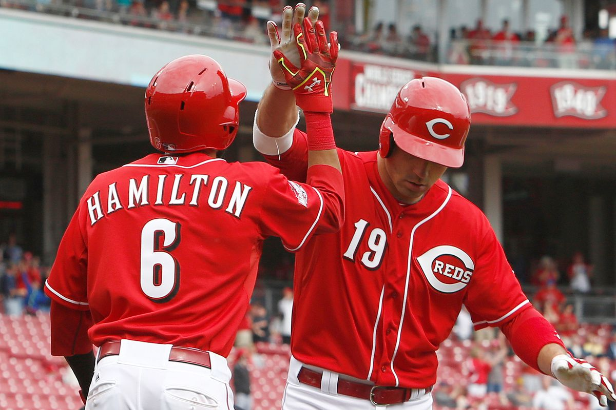 Billy Hamilton congratulates Joey Votto after Votto's solo home run against the Cardinals. Both players are key attributes to the Reds' offense.