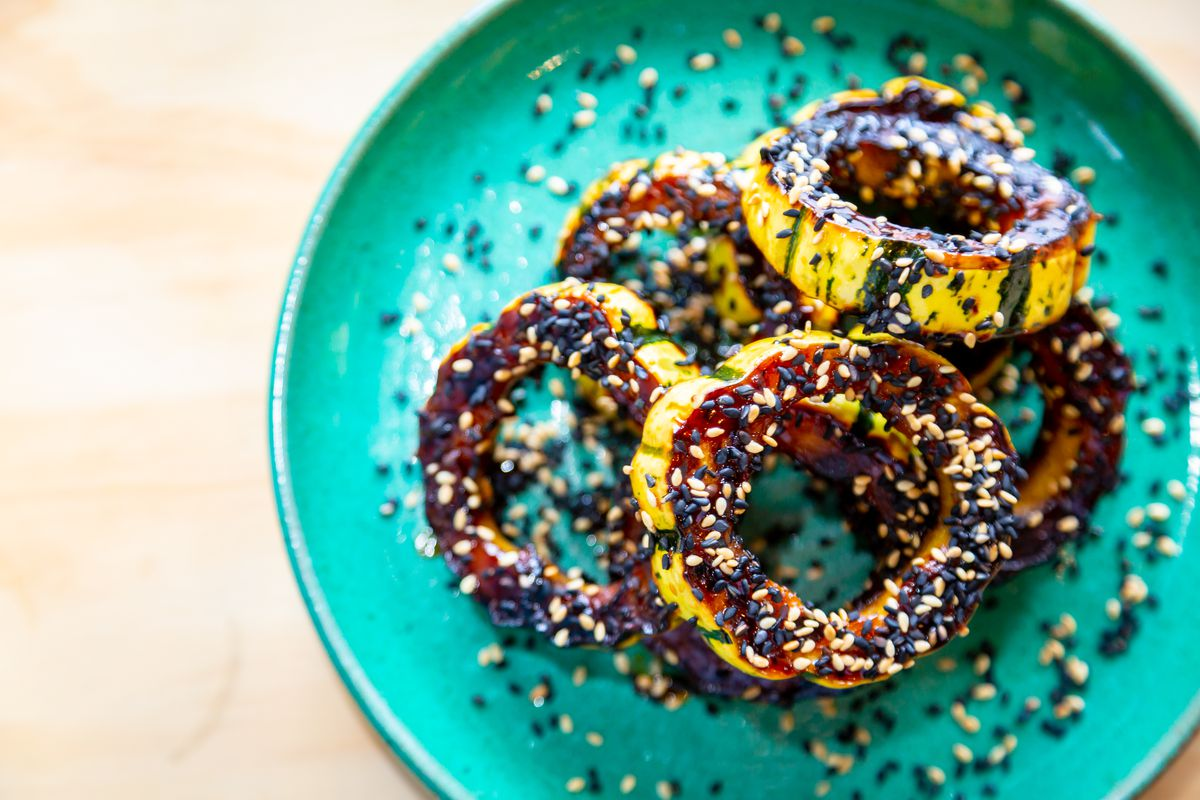 Roasted delicata squash with maple, chili agro dolce, and benne seed
