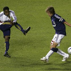 RSL's Robbie Findley, left, gets the ball past Carey Talley of Chivas USA Wednesday at Rio Tinto Stadium. Findley scored twice in the game.