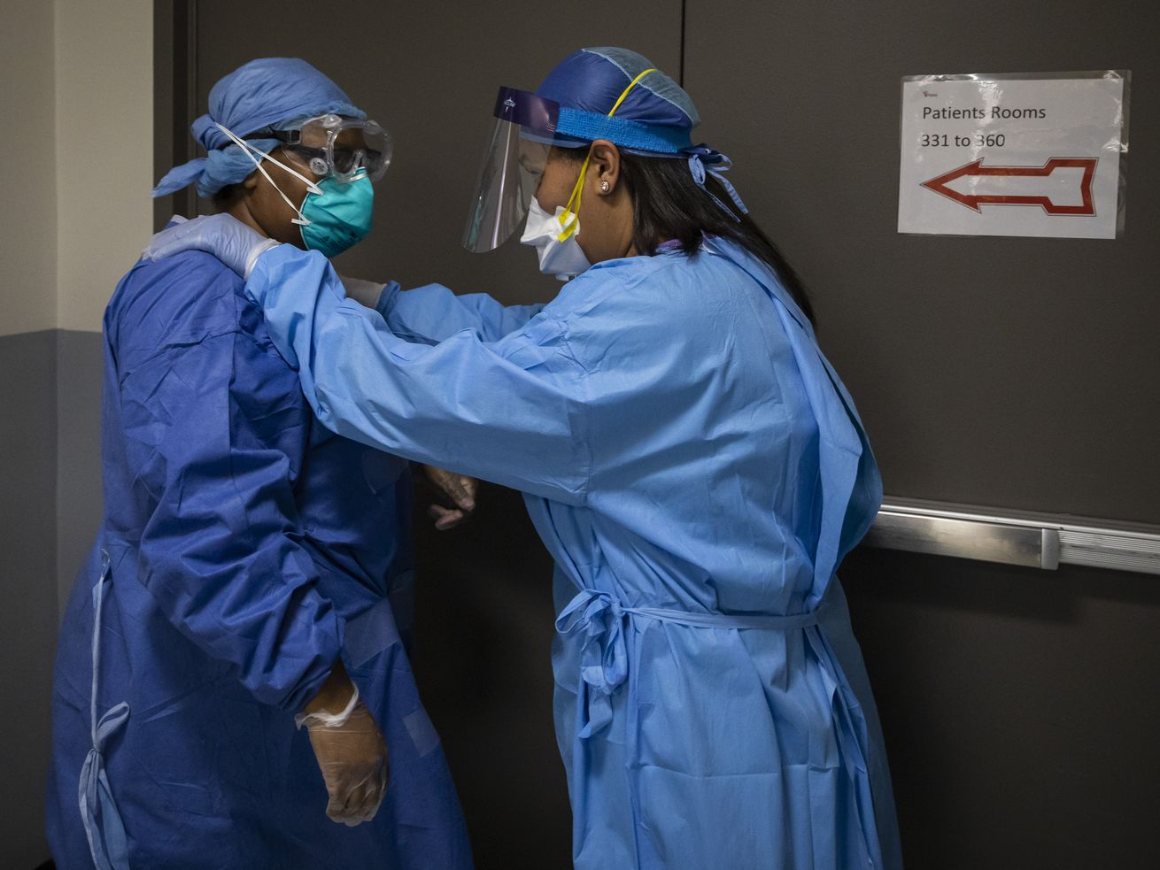 Nurse practitioner Capri Reese, right, gives a pep-talk to nurse Tamara Jones in the COVID-19 unit earlier this year at Roseland Community Hospital. Illinois is in the midst of its deadliest stretch of the pandemic.