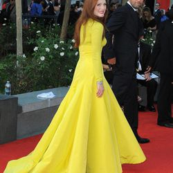 """Actress Julianne Moore, left and husband Bart Freundlich arrive at the 64th Primetime Emmy Awards at the Nokia Theatre on Sunday, Sept. 23, 2012, in Los Angeles.  Moore is nominated for best actress in a miniseries or movie for her role as Sarah Palin in """"Game Change."""""""