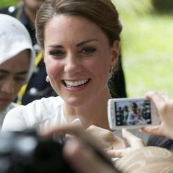Kate, the Duchess of Cambridge shakes hands with well-wishers during a walk through a central city park in Kuala Lumpur, Malaysia, Friday, Sept. 14, 2012.  Prince William and Kate are on a nine-day tour of the Far East and South Pacific in celebration of Queen Elizabeth II's Diamond Jubilee.