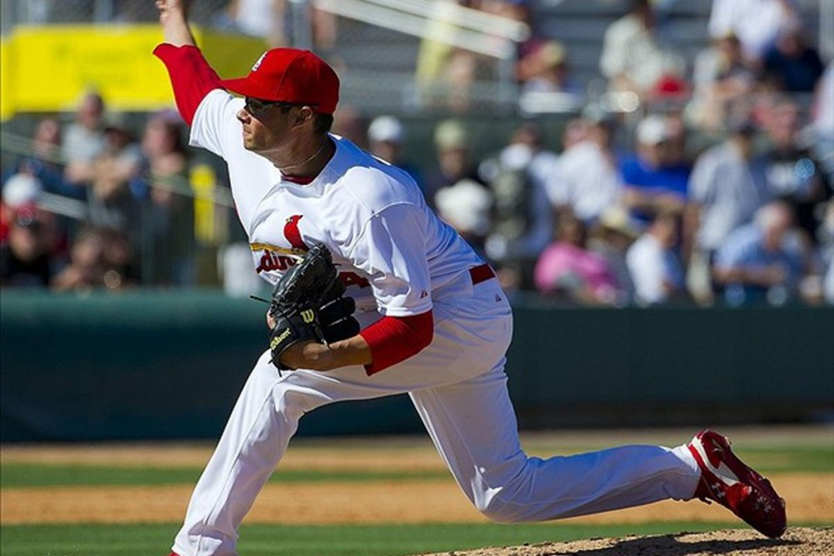 This is Joe Kelly. He wears goofy reliever goggles and throws really hard. I love Joe Kelly.