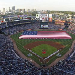 A large United States flag is stretched  across the field during home opening ceremonies before a baseball game between the Milwaukee Brewers and the Atlanta Braves in Atlanta, Friday, April 13, 2012.