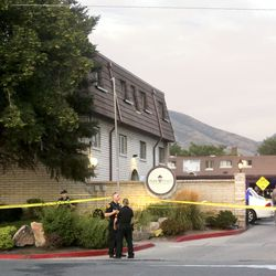 Salt Lake City police work at the scene of an officer-involved shooting outside thePark Place Apartments, 350 E. 700 Southon Monday, Aug. 5, 2019.